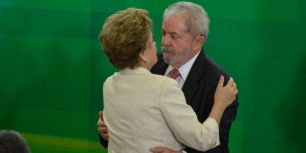 BRASILIA, BRAZIL - MARCH 17: Brazil's former president, Luiz Inacio Lula da Silva hugs Brazil President...