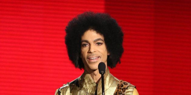 Prince presents the award for favorite album - soul/R&B at the American Music Awards at the Microsoft...