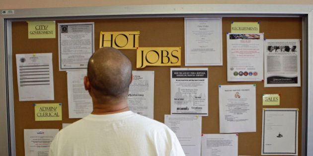 A job seeker checks for new jobs postings at the Glendale Workforce Services Center Thursday, Aug. 19,...