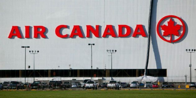 Cars sit parked in front of the Air Canada hanger at Vancouver International Airport (YVR) in Richmond,...