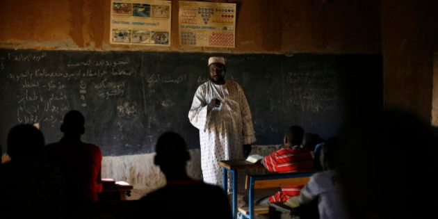 In this Monday, Feb. 18, 2013 photo, Mohamed Salia teaches in his madrassa (relgious school) in Gao,...