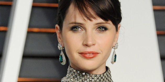 BEVERLY HILLS, CA - FEBRUARY 22:  Actress Felicity Jones arrives at the 2015 Vanity Fair Oscar Party Hosted By Graydon Carter at Wallis Annenberg Center for the Performing Arts on February 22, 2015 in Beverly Hills, California.  (Photo by Jon Kopaloff/FilmMagic)
