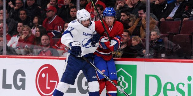 MONTREAL, QC - MARCH 10: Alex Killorn #17 of the Tampa Bay Lightning body checks Jeff Petry #26 of the...