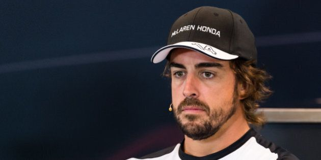 McLaren driver Fernando Alonso of Spain addresses the media at the Spa-Francorchamps circuit, Belgium,...