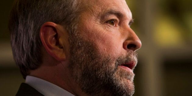Thomas 'Tom' Mulcair, leader of the New Democratic Party, center, speaks to the media following the second...