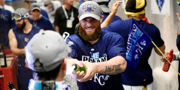 KANSAS CITY, MO - OCTOBER 23: Jonny Gomes #31 of Kansas City Royals celebrates in the clubhouse after...