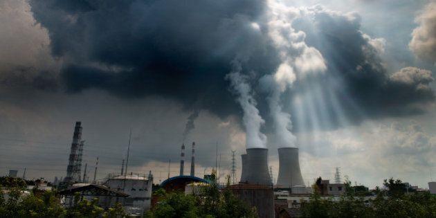 Smoking industrial chimneys at dawn. Concept for environmental