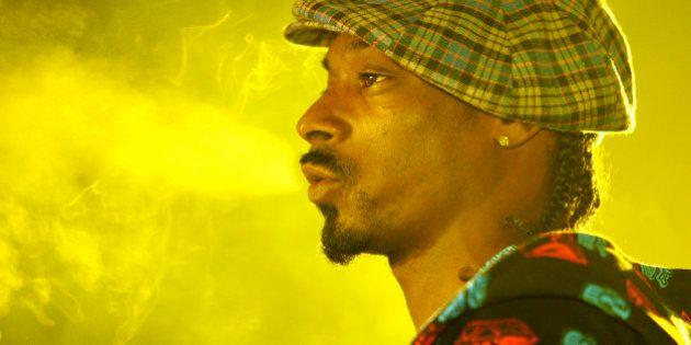 Snoop Dog performs during the T-Mobile NBA All-Star 2006 party in Houston, Texas, Saturday, Feb. 18, 2006. (AP Photo/Chris Polk)