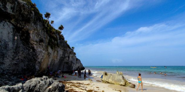 QUINTANA ROO, Oct. 6, 2015 -- Tourists are seen on a beach in Tulum, Quintana Roo state of Mexico, on Oct. 5, 2015. The beaches of Cancun and Tulum have been nominated as Mexico and Central America's leading beach destination 2015 in the World Travel Awards. (Xinhua/Francisco Galvez/NOTIMEX via Getty Images)