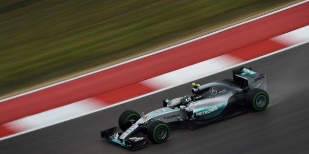 Mercedes AMG Petronas driver Nico Rosberg of Germany corners in a wet track during the first practice...