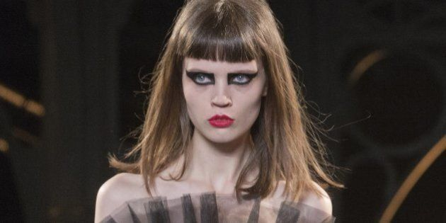A model wears a creation for Saint Laurent's Fall/Winter 2015-2016 Ready to Wear fashion collection presented in Paris, as part of Paris Fashion Week, Monday, March 9, 2015. (AP Photo/Jacques Brinon)