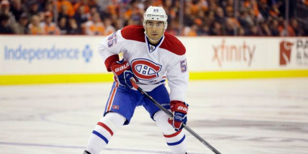 Montreal Canadiens' Francis Bouillon in action during an NHL hockey game against the Philadelphia Flyers, Wednesday, Jan. 8, 2014, in Philadelphia. (AP Photo/Matt Slocum)