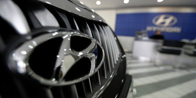 The logo of Hyundai Motor Co. is seen on a car displayed at the company's showroom in Seoul, South Korea, Thursday, April 23, 2015. The maker of Genesis sedan and Sonata said Tuesday its net income was down 2 percent over a year earlier to 1.98 trillion won ($1.83 billion) while operating income sank 18 percent to 1.59 trillion won. (AP Photo/Ahn Young-joon)