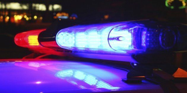 A close-up photo of police lights by night