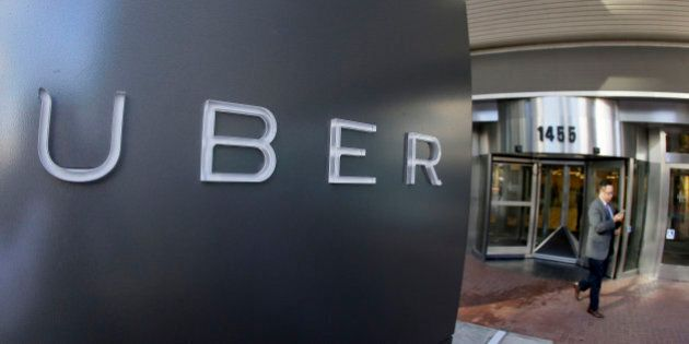 FILE - In this Dec. 16, 2015, file photo, a man leaves the headquarters of Uber in San Francisco. The...