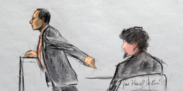 In this courtroom sketch, Assistant U.S. Attorney Aloke Chakravarty is depicted pointing to defendant...