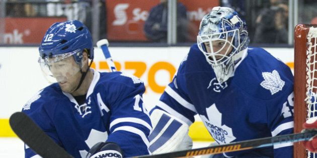 TORONTO, ON - OCTOBER 3: Stéphane Robidas helps out Jonathan Bernier in the second period. The Toronto...
