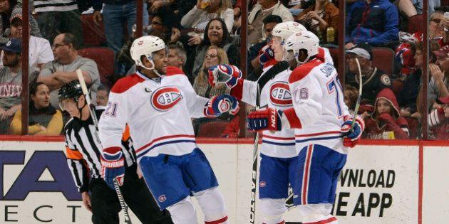 GLENDALE, AZ - MARCH 07: Lars Eller #81 of the Montreal Canadiens (C) celebrates with teammates Devante...