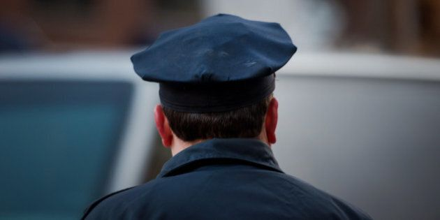 A New York Police Department (NYPD) offficer manages traffic on Madison Avenue in New York, U.S., on...