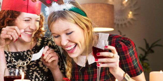 Friends laughing at joke at Christmas dinner