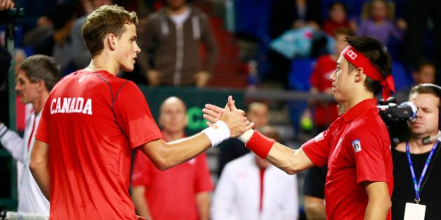 VANCOUVER, CANADA - MARCH 6: Vasek Pospisil of Canada congratulates Kei Nishikori of Japan after their...