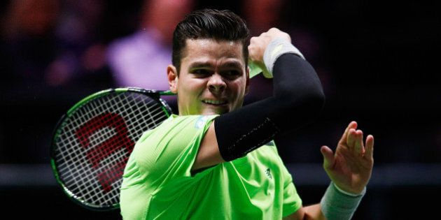 ROTTERDAM, NETHERLANDS - FEBRUARY 10: Milos Raonic of Canada in action against Andrey Kuznetsov of Russia...