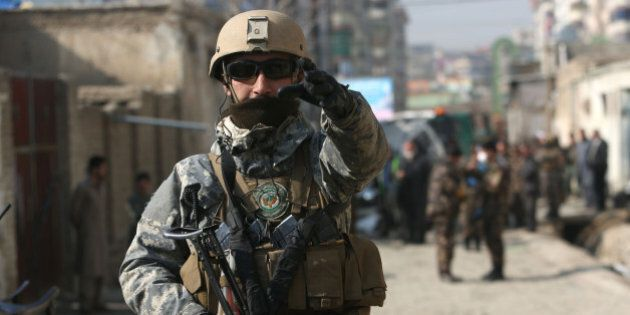 Afghan security forces inspect the site of a suicide attack in Kabul, Afghanistan, Saturday, Nov. 28,...