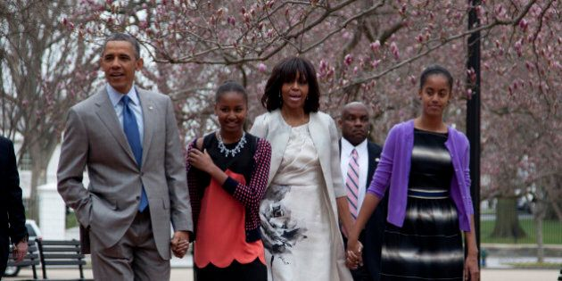 President Barack Obama and first lady Michelle Obama walk from the White House with their daughters Sasha...
