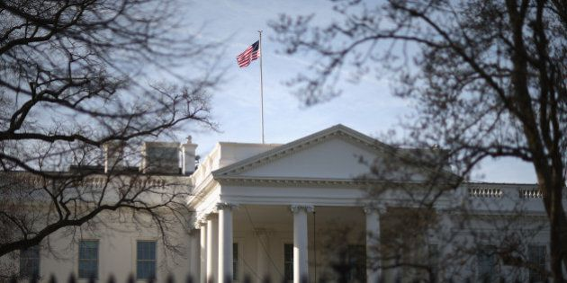 WASHINGTON, DC - MARCH 18: Morning sunlight strikes the flag flying above the White House March 18, 2015...