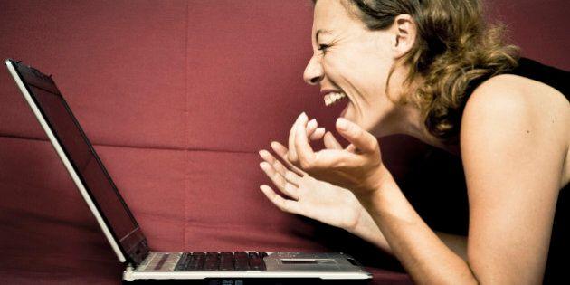 woman looking at his computer