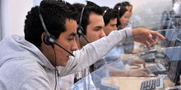 TO GO WITH AFP STORY BY JOSE BAUTISTA - Young telemarketers work in a call center in Manizales, Caldas...