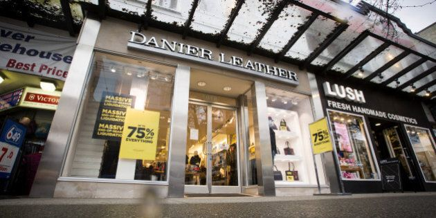 Sale signs are displayed outside of a Danier Leather store in downtown Vancouver, British Columbia, Canada, on Thursday, Feb. 4, 2016. Danier Leather filed a notice of intention to make a proposal (NOI) pursuant to provisions of the Bankruptcy and Insolvency Act. Photographer: Ben Nelms/Bloomberg via Getty Images