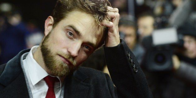 British actor Robert Pattinson poses for photographers upon arrival for the screening of the film 'Life'...