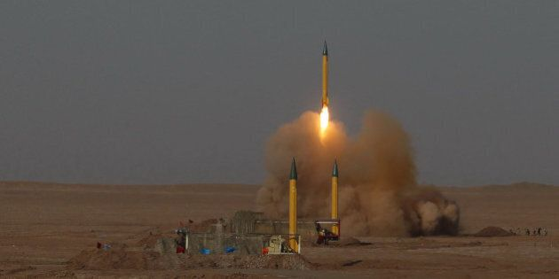 In this picture released by the Iranian Fars News Agency, asurface-to-surface missile is launched during...