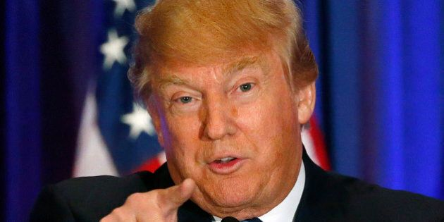 Republican presidential candidate Donald Trump addresses the media during a press conference on March...
