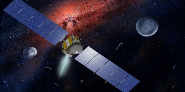 This undated artist's concept released by NASA and UCLA shows the Dawn spacecraft with Ceres and Vesta....