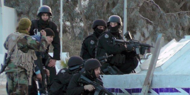 Tunisian special forces take position during clashes with militants in the southern town of Ben Guerdane,...