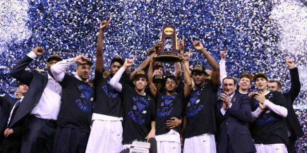 INDIANAPOLIS, IN - APRIL 06: The Duke Blue Devils celebrate with the championship trophy after defeating...