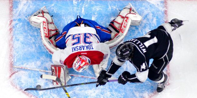 Los Angeles Kings right wing Justin Williams, right, tries to get a shot in on Montreal Canadiens goalie...
