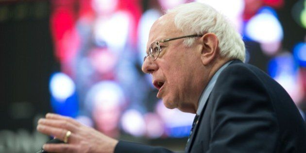 Democratic presidential candidate Bernie Sanders peaks at a rally on the campus of Southern Illinois...