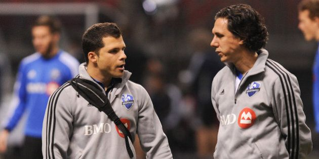 VANCOUVER, CANADA - MAY 29: Paolo Pacione (L) and assistant coach Mauro Biello (R) of the Montreal Impact confer during warm-ups prior to a match against the Vancouver Whitecaps during the finals of the Amway Canadian Championship at B.C. Place on May 29, 2013 in Vancouver, British Columbia, Canada. (Photo by Derek Leung/Getty Images)