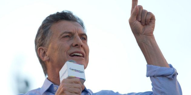 Opposition presidential candidate Mauricio Macri talks to supporters during the closing campaign rally...