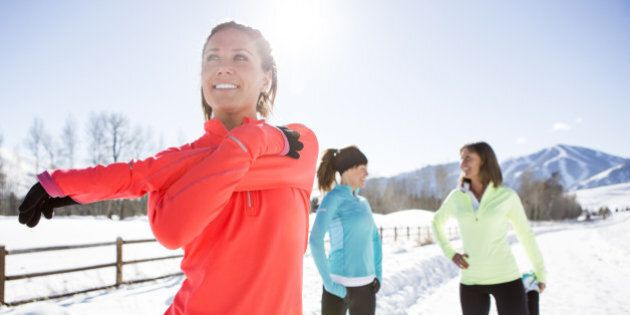 Three women jogging a snowy path in Sun Valley on a beautiful winter