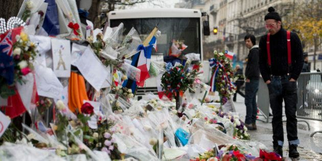 Jesse Hughes(R), singer of the US rock group Eagles of Death metal pays tribute to the victims of the...