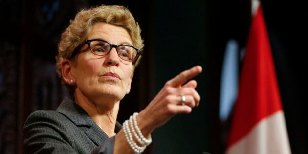 TORONTO, ON - MARCH 26: Premier Kathleen Wynne responds to breach of trust allegations made by Tim Hudak...