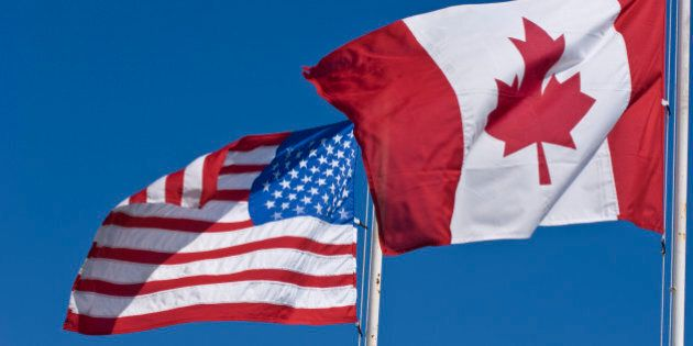 Canadian and United States flags on blue