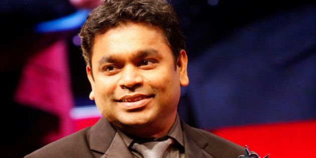 Indian artist AR Rahman smiles as he receives the award for Outstanding Achievement inn Music at The...