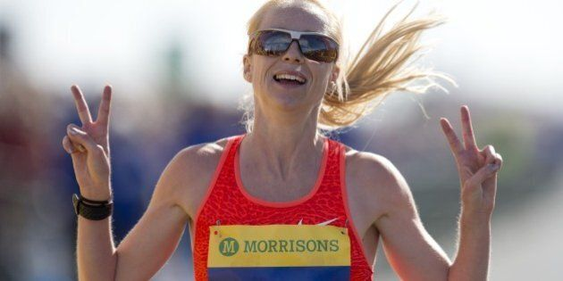 Britain's Gemma Steel celebrates coming second in the women's elite race in the Great North Run half-marathon in South Shields, north east England on September 13, 2015.  The Great North Run is Britain's largest running event with more than 50,000 participants set to cover the 13.1 miles from Newcastle to South Shields. AFP PHOTO / OLI SCARFF        (Photo credit should read OLI SCARFF/AFP/Getty Images)