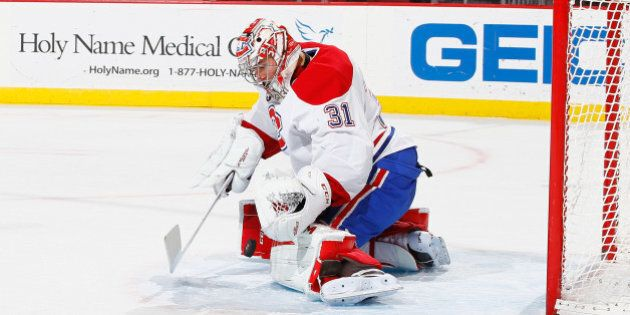 NEWARK, NJ - JANUARY 02: Carey Price #31 of the Montreal Canadiens makes a save against the New Jersey...