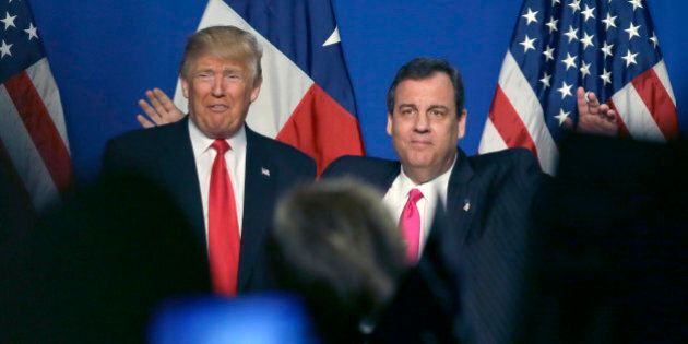 Republican presidential candidate Donald Trump stands with New Jersey Gov. Chris Christie during a rally...